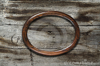 Frame on old wooden background