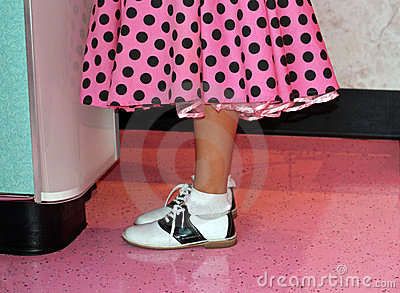 Pink poodle skirt and saddle shoes