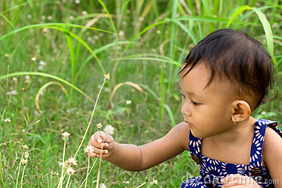 Baby playing in nature