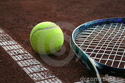 Tennis ball and a racket