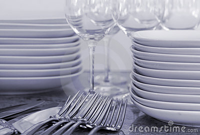 Plates, wineglasses, cutlery - toned image