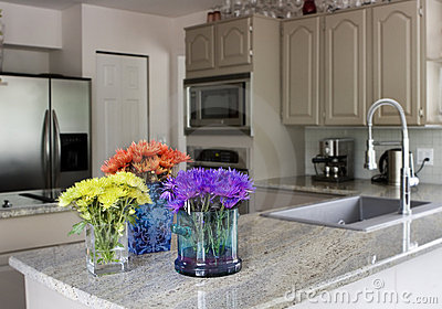 Modern kitchen with flowers on counter