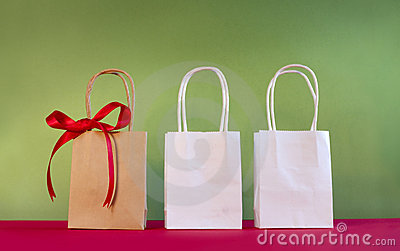 Three bags decorated with bow on red and breen bac