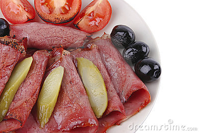 Sliced served sausage with salted