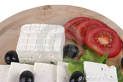 Feta cheese with olives on plate