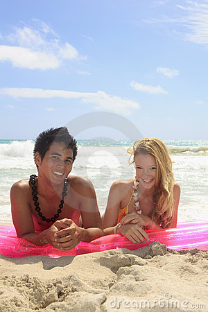 Couple lying on a raft at the beach