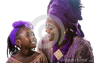 Mother and child girl looking to each other.African traditional clothing