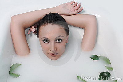Woman relaxing in a bathroom
