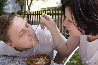 The young woman feeds her husband