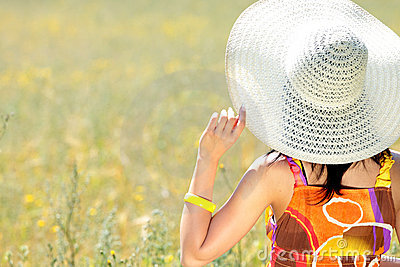 Young happy woman in grain field