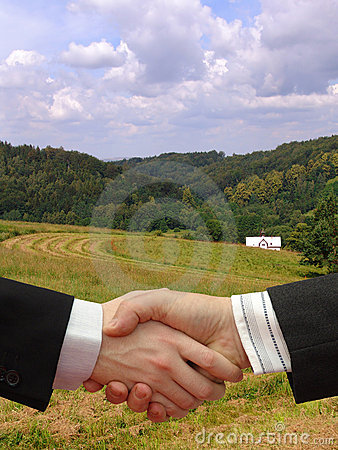 Businessmen shaking hands in the green Nature