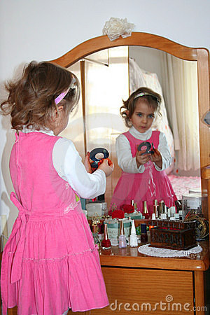 Small girl using make-up