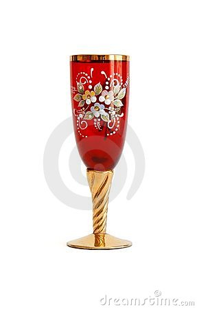 Red wine glass with flower pattern and a golden st