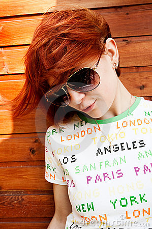 Red-haired girl in sunglasses