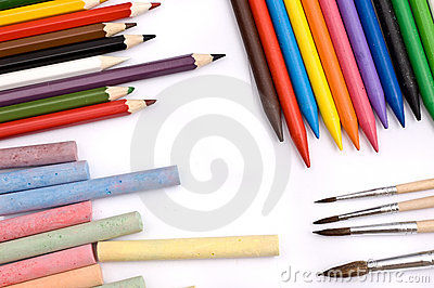 Colorful pencils, crayons, chalks and paintbrushes