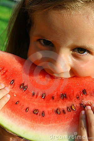 Little girl eating melon