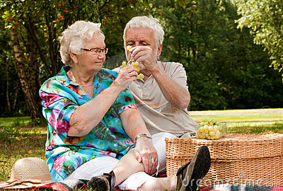 Senior couple sharing the grapes