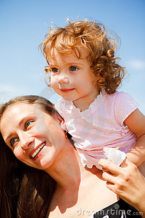 Cheerful mother and baby girl