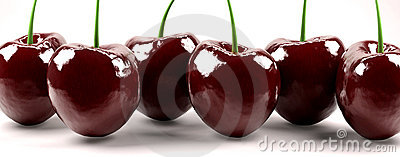 Shot of six red cherries
