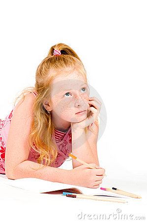 A young girl is concentrating