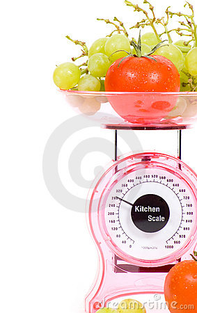 Kitchen Scales with fresh tomatoes and grapes