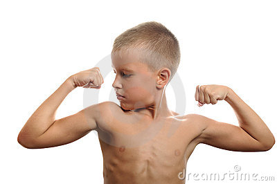 Young boy flexes his muscles