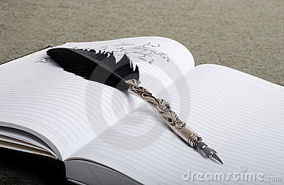 A feather on notebook