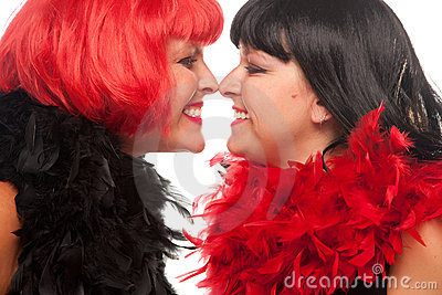 Red and Black Haired Women Smiling at Each Other