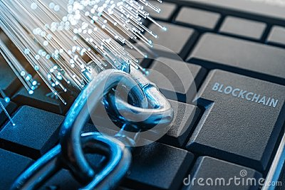Blockchain technology concept. The chain lies on the keyboard