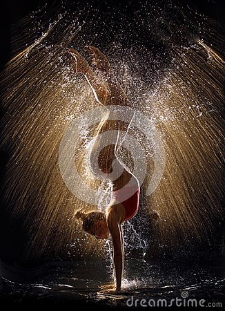 Gymnast in the spray of water