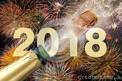 Popping champagne and fireworks at new years eve 2018