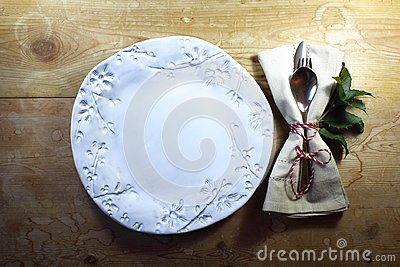 Rustic casual country dinner place setting with hand made plate for Thanksgiving or Christmas