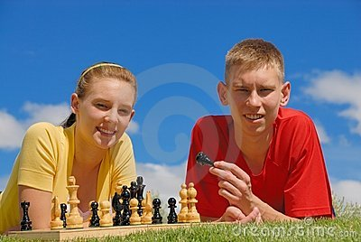 Siblings play chess