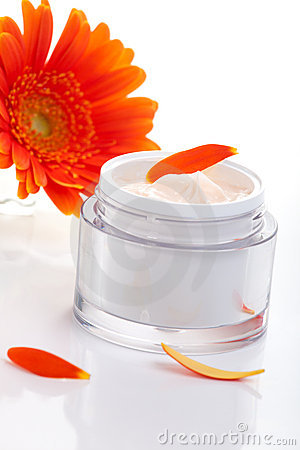 Face cream and gerbera flowers