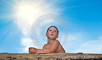 The boy against the blue sky