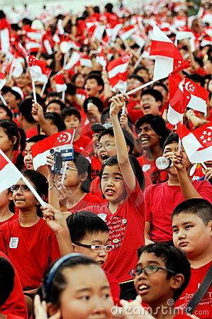 Students waving Singapore flags during NDP 2009