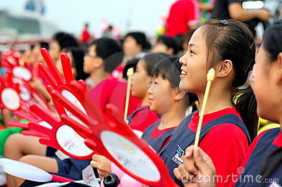 Students using handheld drums during NDP 2009