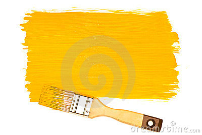 Yellow paint and brush