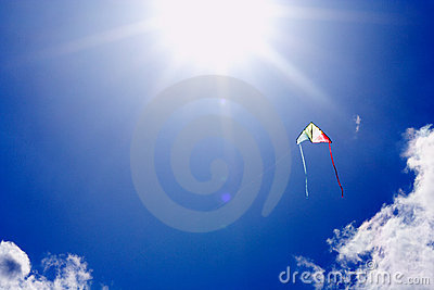 Kite flying in sunlit sky