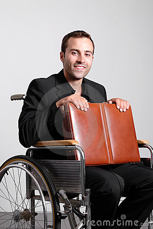 Young disabled business man in wheelchair