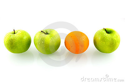 Green fresh apples with one orange