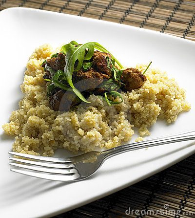 Chicken meat on couscous