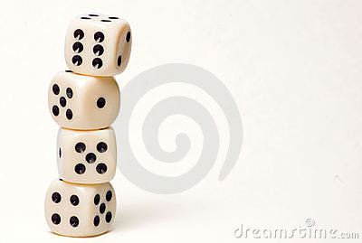 4 dice piled up in front of white background