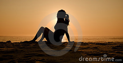 Silhouette beach girl