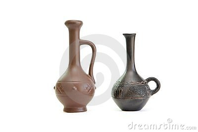 Two small elegant jugs isolated