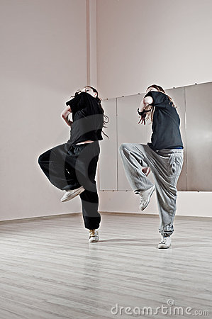 Two girls dancing synchronously