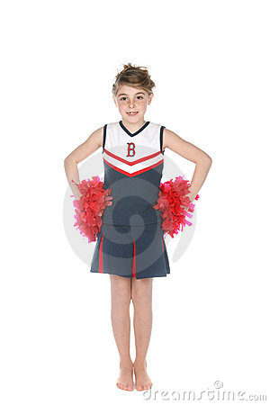 Cute girl in cheerleader outfit and pompoms