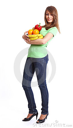 Young smiling woman with fruits