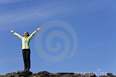 Woman Celebrating On Top Of A Mountain