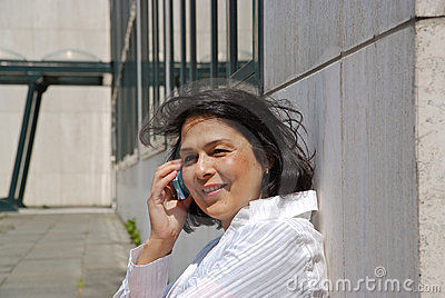 Businesswoman with cellphone outside